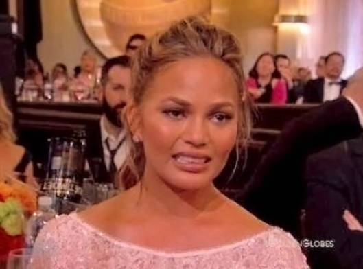 chrissy teigen golden globes cry face